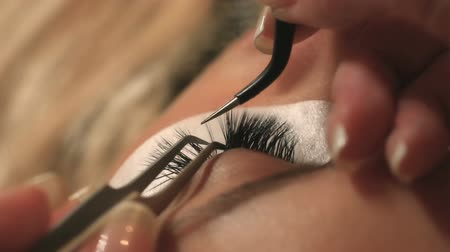 cílios : Woman Eye with Long Eyelashes. Eyelash Extension. Lashes, close up, selected focus. Vídeos