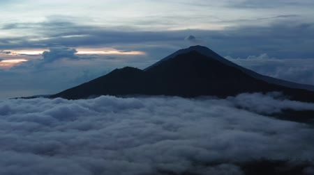 Aerial view. Active Indonesian volcano Batur in the tropical island Bali. Indonesia. Batur volcano sunrise serenity. Dawn sky at morning in mountain. Serenity of mountain landscape, travel concept