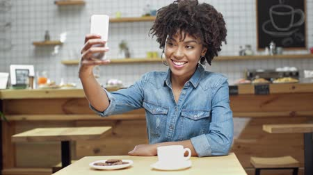 drinking coffee : Woman taking selfie