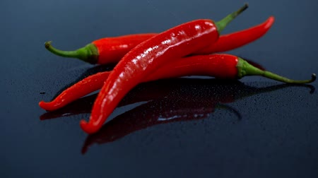 red chili pepper : studio shot of water spraying on red chili Stock Footage
