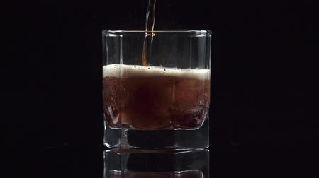 aerated : studio shoot of drink with ice cubes isolated on black