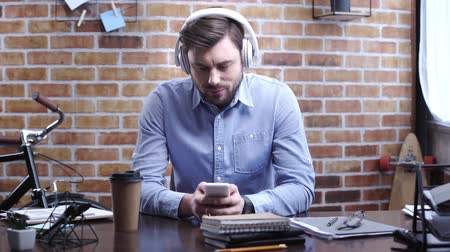 longboard : Concentrated businessman using headset