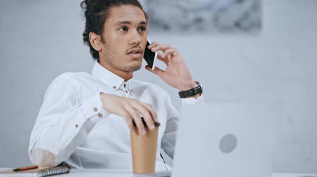 good looking guy : handsome and good-looking businessman is on the phone Stock Footage