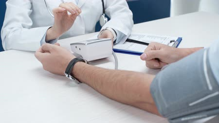 hypertension : cropped view of female doctor consult male patient