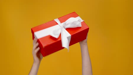 ostříhané : red gift box with ribbon on yellow background