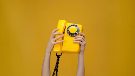 vintage : vintage rotary dialing isolated on yellow Stock Footage