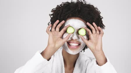 clay mask : Cheerful women with mask on face