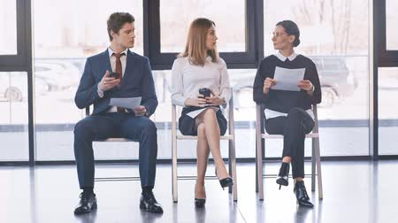 resumes : Interview candidates in smart wear waiting