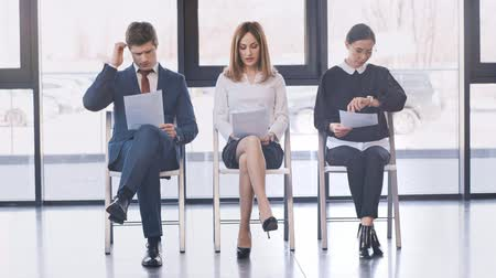 resumes : three people waiting for interview