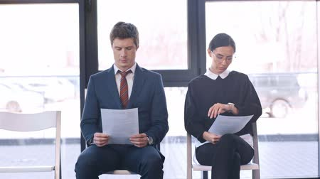 resumes : Candidates waiting for job interview Stock Footage