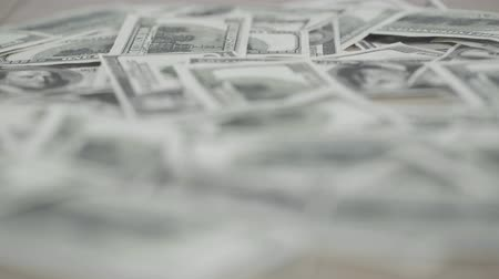 lő : close up view of messy dollar banknotes on table Stock mozgókép