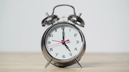 구식 : shiny metal vintage alarm clock ringing isolated on gray