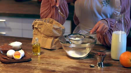 kitchen paper : paper bag into glass bowl