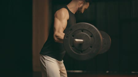 powerlifter : Bearded muscular powerlifter in white shorts training with barbell Stock Footage
