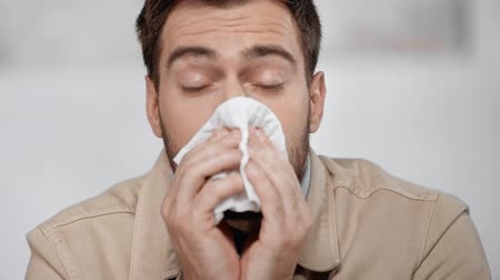 biznesmen : looking coughing, sneezing and blowing nose in tissue