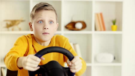 elementary age : A boy driving after playing video game