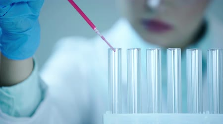 pipette : of partial test tubes in laboratory Stock Footage
