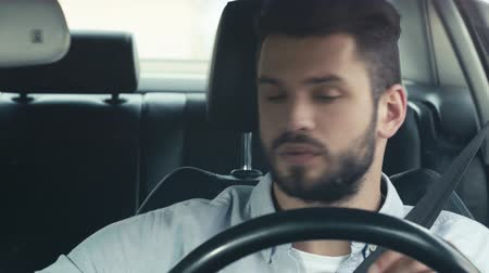close cropped : selective focus of man driving a car Stock Footage