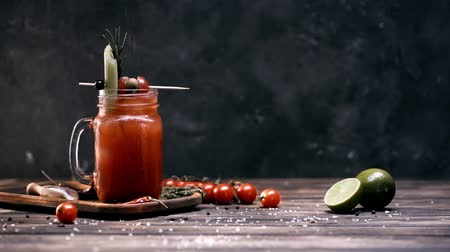 fogpiszkáló : ground pepper falling in glass with bloody mary cocktail on black