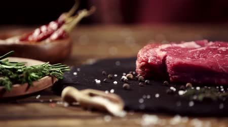 塩辛い : falling rosemary on raw meat steak on table with ingredients