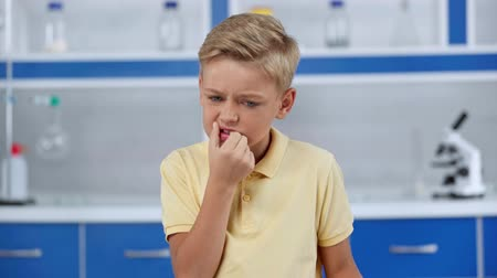 a medicare : focus pull of boy holding tooth