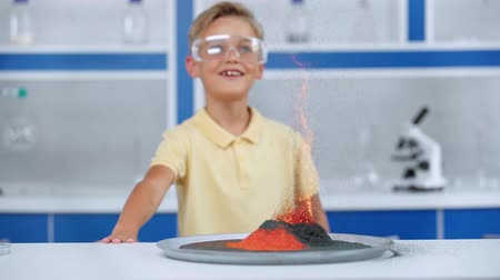 focus pull : Hyperlapse of kid looking at burning orange powder Stock Footage