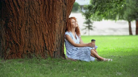 redhair : cheerful redhead girl drinking coffee to go