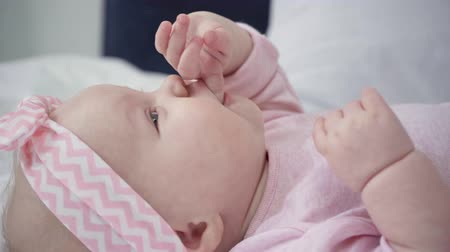 headband : selective focus of cute baby sucking fingers Stock Footage