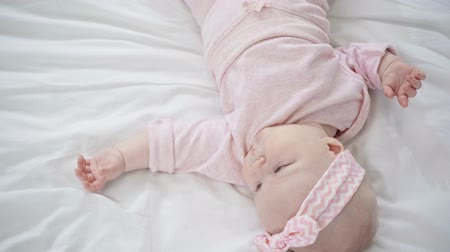 headband : top view of adorable baby lying on bed
