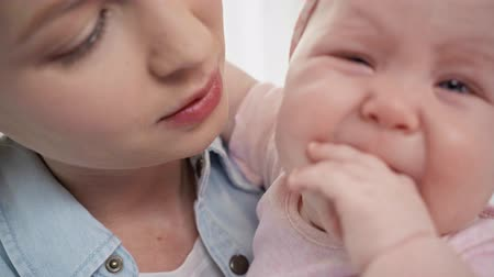 headband : close up of attractive mother holding in arms crying baby