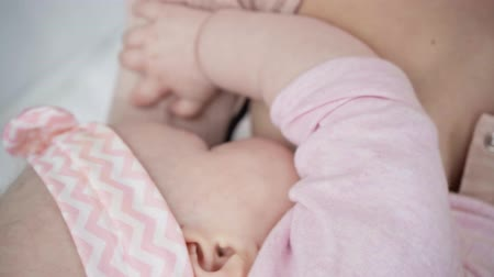 cropped view of mother breastfeeding infant daughter Stok Video