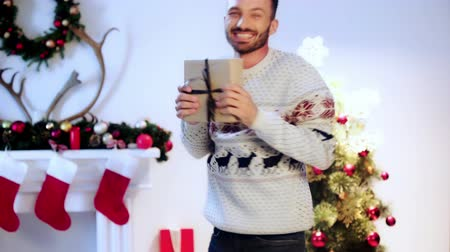 new clothes : happy bearded man holding gift on christmas Stock Footage