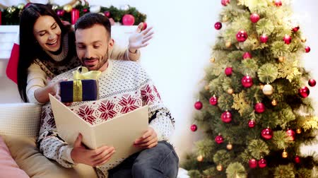 stockings : wife covering eyes of husband and giving present Stock Footage