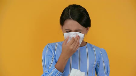 bad mood : sad child crying and wiping tears isolated on yellow Stock Footage