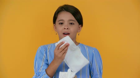 bad mood : sad sick girl blowing her nose and wiping tears with napkin Stock Footage