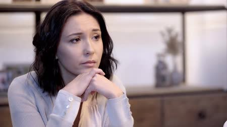 bad mood : attractive and upset woman touching head in apartment Stock Footage