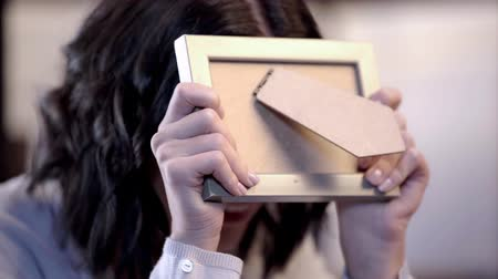 bad mood : sad woman crying and holding photo frame