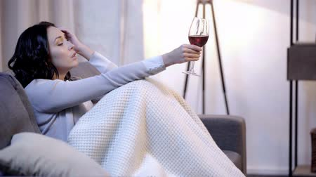 bad mood : side view of woman holding wine glass