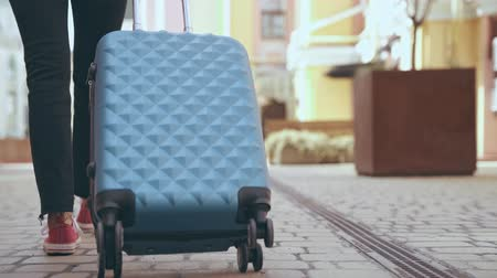 paving : cropped view of woman walking with suitcase Stock Footage