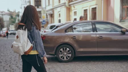 paving : young woman crossing the street Stock Footage