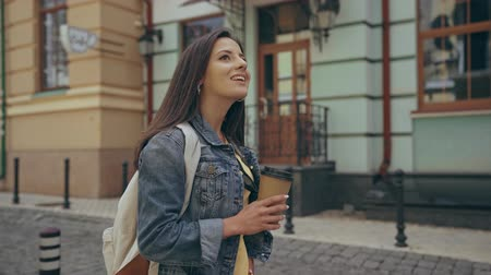 paving : woman walking and drinking coffee Stock Footage