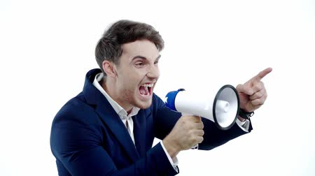 мегафон : slow motion of businessman screaming in megaphone isolated on white