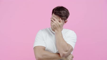 facepalm : displeased man showing facepalm isolated on pink Stock Footage
