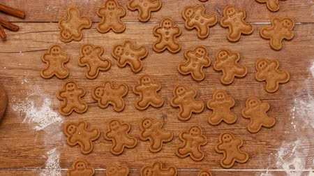 closing : Top view of making gingerbread cookies for the holiday season - stop motion animation, camera closing in Stock Footage