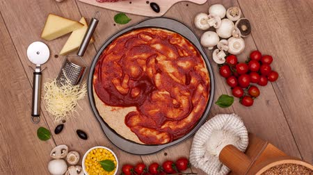 salame : Top view of making a pizza with ingredients appearing on the slowly rotating setting - stop motion animation, camera rotates Vídeos