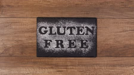 kasza jaglana : Gluten free diet options - various seeds, grains and products slide out of frame around black plate with writing in flour, stop motion animation
