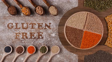kasza jaglana : Gluten free diet options - various seeds and grains in wooden spoons with writing in flour, stop motion animation Wideo