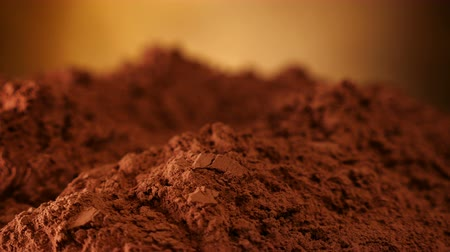 ароматический : Cocoa powder heap rotate in front of camera - close up