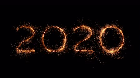 jiskry : Happy new year. The numbers 2020 made of real sparkler twinkles and sparks isolated on black background. Whirly fire streaks design element for any dark background - UHD resolution.