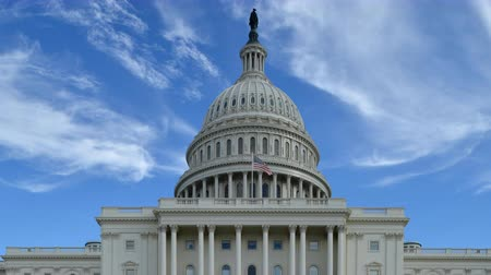 state capital : Establishing shot of the Capitol Building in Washington, DC. 4K UHD broadcast quality. U.S politics concept.